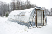 Wooden diy homemade greenhouse polythene snow — Stock Photo