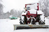 Old russian soviet tractor covered snow in winter — Foto de Stock