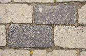Background of old grunge street pavement of brick — Stock Photo