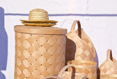 Wicker wooden baskets and hats sold at market fair — Stock Photo