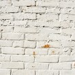 Background red brick wall painted white paint — Stock Photo