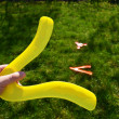 Hand hold boomerang thrown flying toy play outside — Stock Photo #10716346