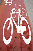 Bicycle path crosses carriageway road section. — Stock Photo