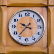 Clock in wooden box showing twentyseven past nine. — Stock Photo