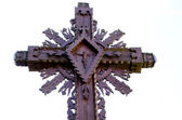 Carved wooden cross with crucified Jesus isolated — Stock Photo