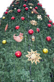 Synthetic Christmas tree decorated toys — Foto de Stock