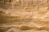 Geological layers of earth in deep sand pit — Stock Photo
