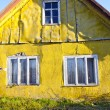 Rural living homestead yellow wall house window — Stock Photo #8824648
