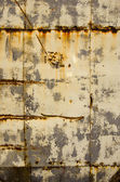 Rusty tin house wall closeup vintage background — Foto Stock