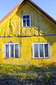 Rural living homestead yellow wall house window — Stock Photo