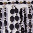 Постер, плакат: Dark black jewelry necklace sell in fair market