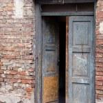 Grunge masonry house doors brick wall background — Stock Photo