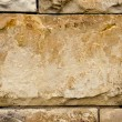 Ancient building walls of stone blocks background — Stock Photo