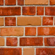 Background of red color brick wall closeup — Stock Photo