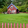 Wooden colorful house well fence rural homestead — Stock Photo