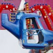 Amusement park rides colorful carousel spin helicopter — Stock Photo #9149054