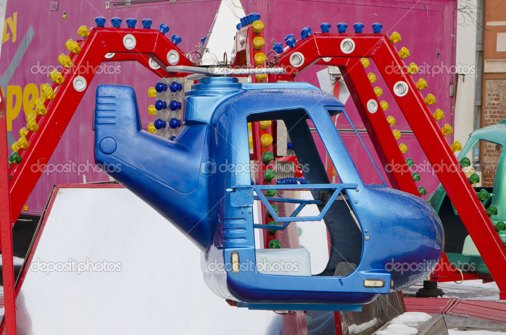 Amusement park rides colorful carousel spin helicopter. — Stock Photo #9149054