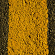 Asphalt yellow road markings macro background — Stock Photo