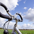 Bicycle handlebar on cloudy sky. No fuel needed — Stock Photo #9466416