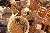 Handmade basket bags stacked pile sell fair market — Stock Photo