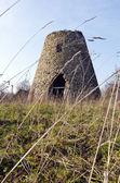 Ancient abandoned windmill built stones nostalgia — Stock Photo