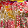 Various colorful suck lollipop sold market sweets — Stock Photo