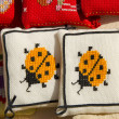 Stock Photo: Handmade sewing pillows ladybird sold fair market