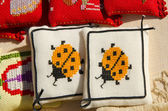 Handmade sewing pillows ladybird sold fair market — Stock Photo