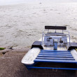 Water bike catamaran on lake concrete pier ship — Stock Photo