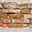 Background of dirty old crumbling brick wall — Stock Photo