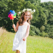 Girl playing with windmill — Stock Photo