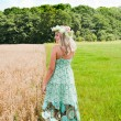 Beautiful woman on the meadow - Stock Photo