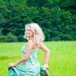 Beautiful girl running on the meadow — Stock Photo