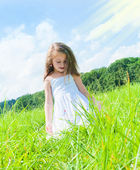 Little girl on the meadow — Stok fotoğraf