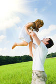 Father and daughter playing in the meadow — Stock Photo