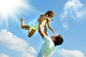 Father and daughter against sky — Stock Photo