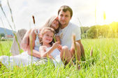 Playful family on the meadow — Stock Photo