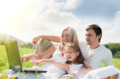 Happy family enjoy outdoors — Stock Photo