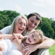Stock Photo: Playful family on meadow