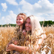 Royalty-Free Stock Photo: Mother and daughter playing at corn