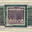 Stock Photo: Window of a old wooden house