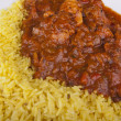 Stock Photo: Chicken jalfrezi with pilau rice