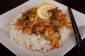 Chicken and shrimp sauce served with rice — Stock Photo