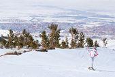 Beautiful skier posing on top of mountain in Palandoken — Stock Photo