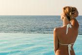 Sexy woman in white bikini looking far — Stock Photo