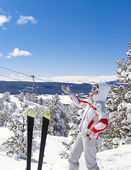 Skier show to beautiful landscape on background — Stock Photo
