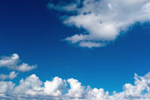 Beautiful blue sky and white clouds as background — Stockfoto