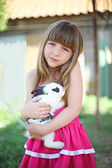 The girl and its fluffy friend — Stock Photo
