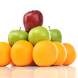 Colorful pyramid of fruits of orange, red apple and green apple — Stock Photo