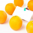 Apple with paper notes inside group of orange — Stock Photo